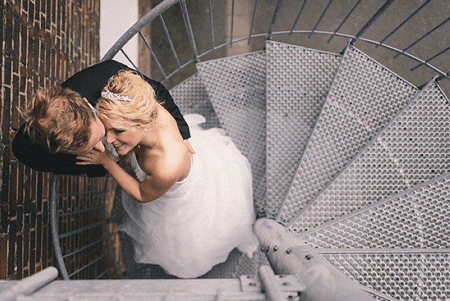 bride and groom on a stairs